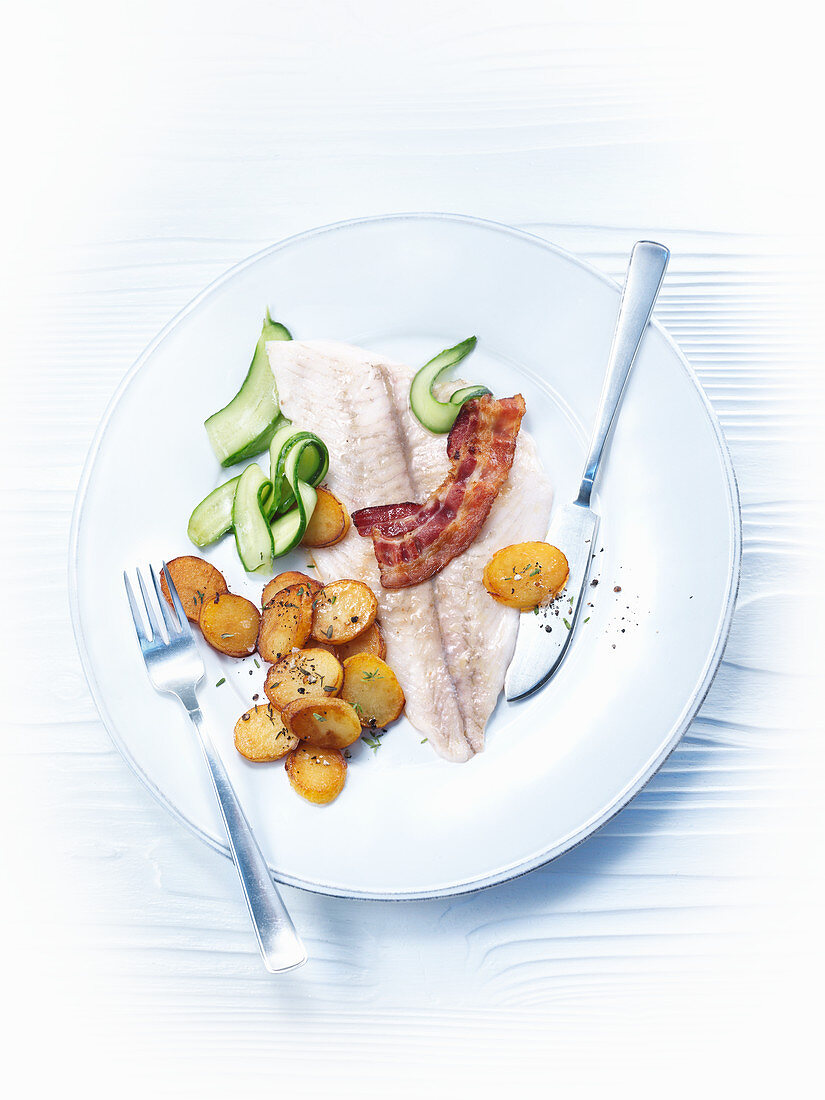 Bacon and plaice with roast potatoes