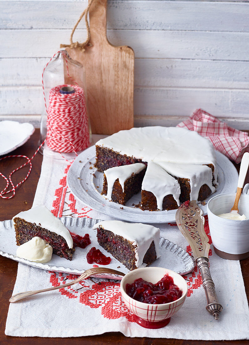 Poppy seed cake with icing and lingonberries