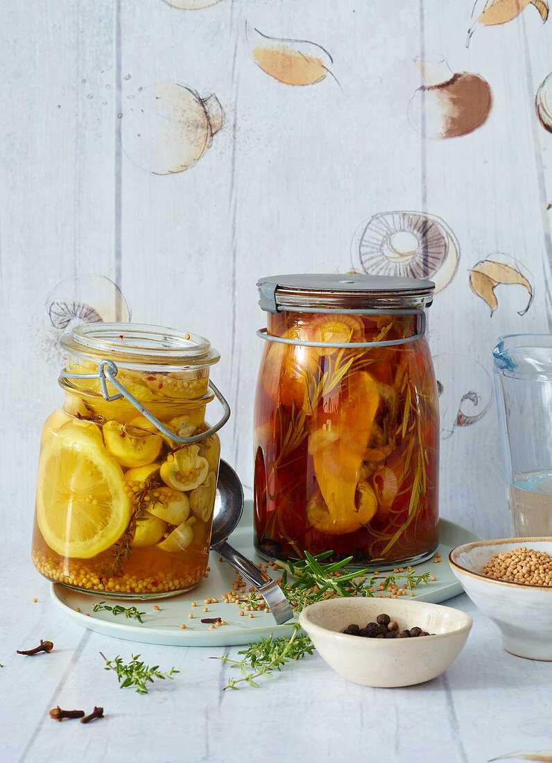 Pickled porccini mushrooms in caramel vinegar and mushrooms pickled in herbs and wine