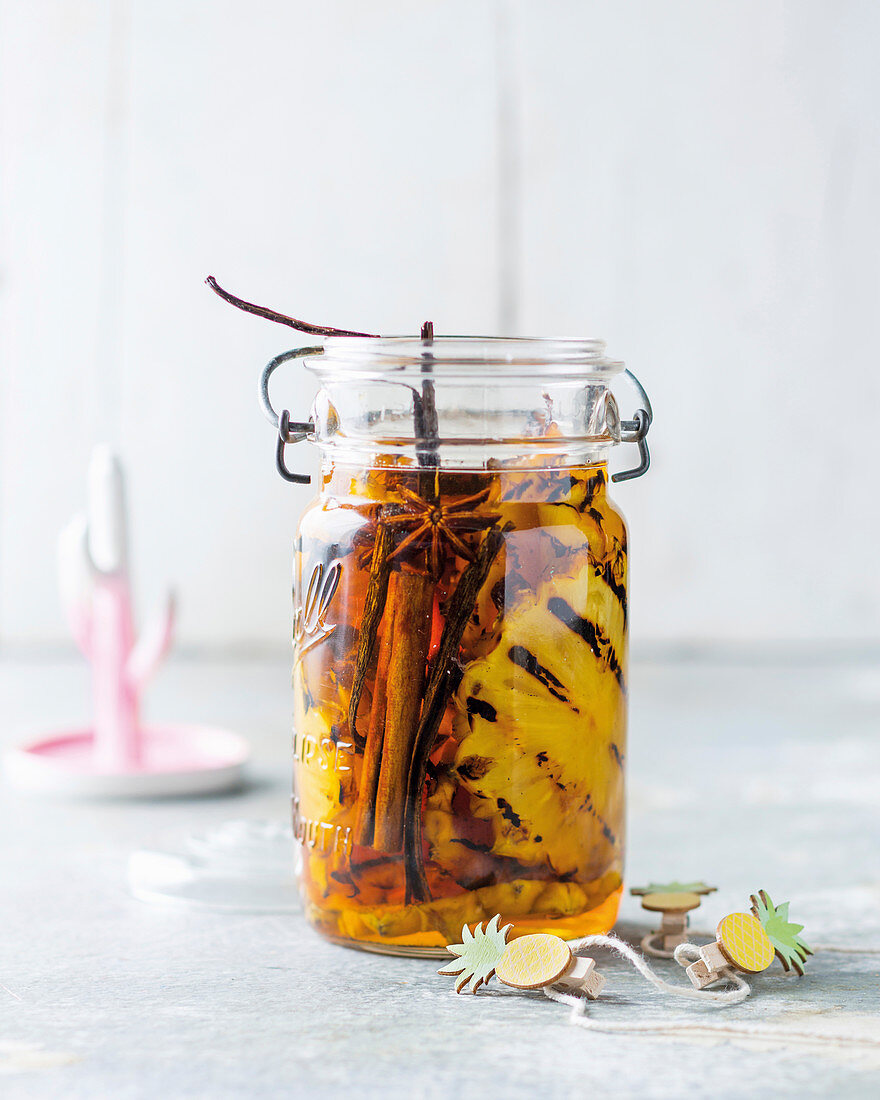Grilled pineapple with spices preserved in rum