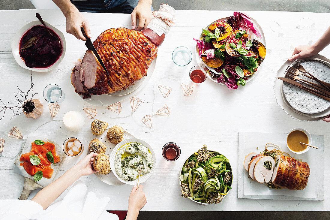 Glazed ham, Roast pumpkin and black rice salad, roast turkey breast and Summer greens, Dip, Buns and Smoked salmon