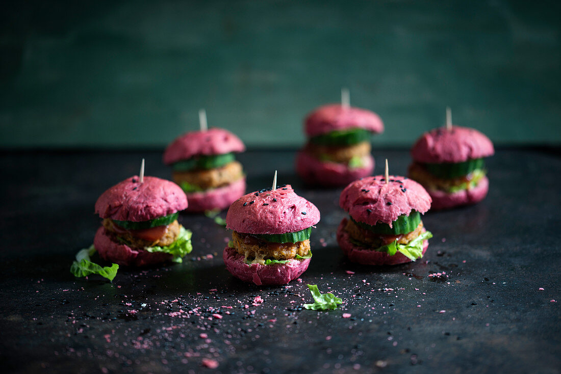 Vegan sliders made from beetroot rolls and bean burgers