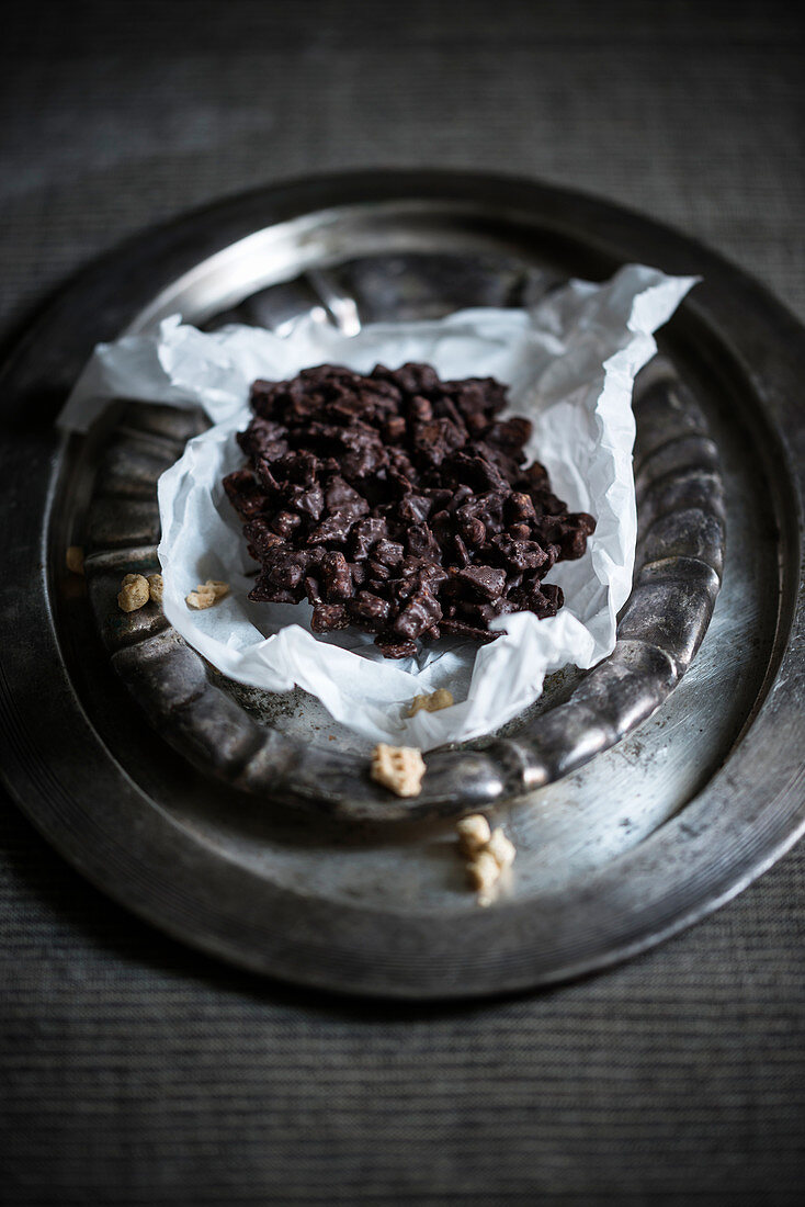 Dark vegan chocolate with pieces of waffle and popped oats