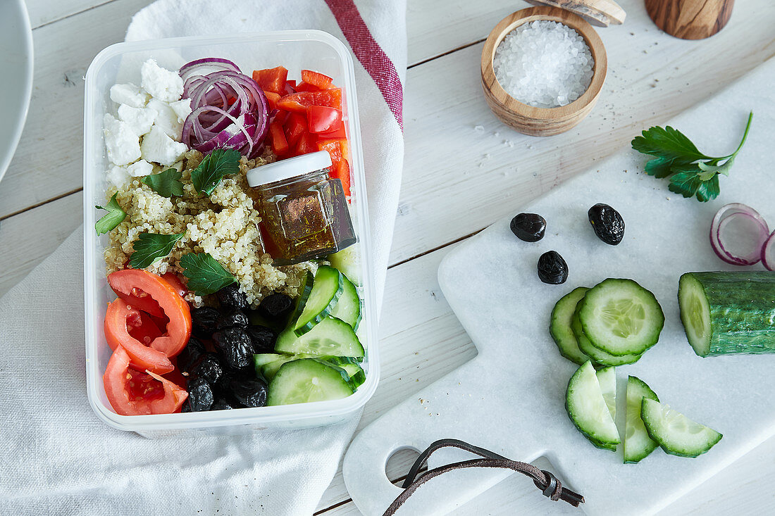 Greek salad with quinoa and a honey and olive oil dressing