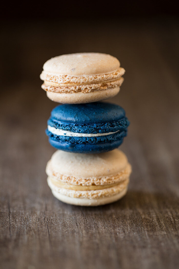 A stack of macaroons filled with salted caramel and vanilla cream