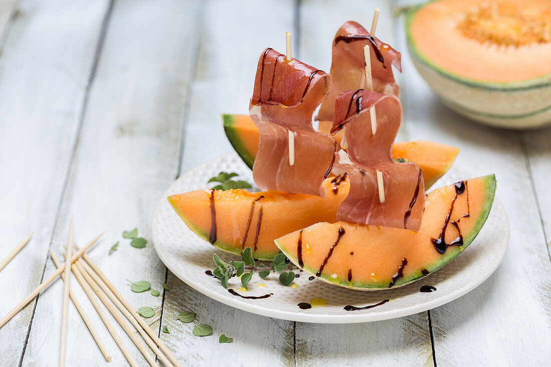 Serrano ham on melon with balsamic sauce