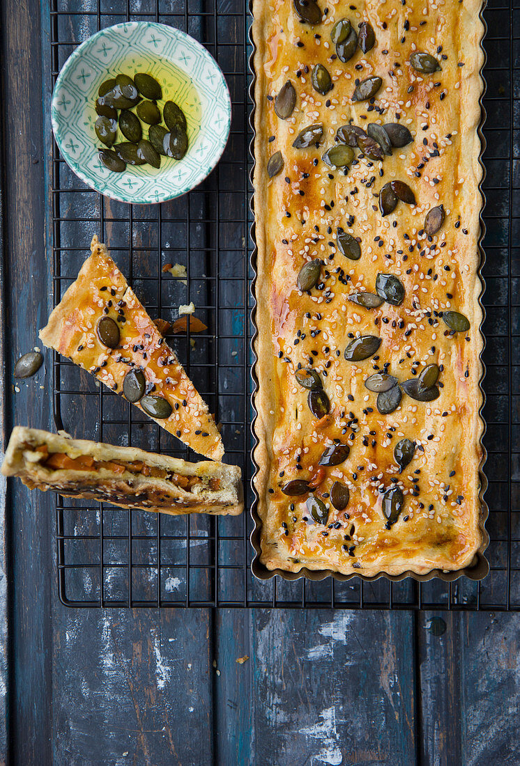 Puff pastry pie with carrots and pumpkin seeds