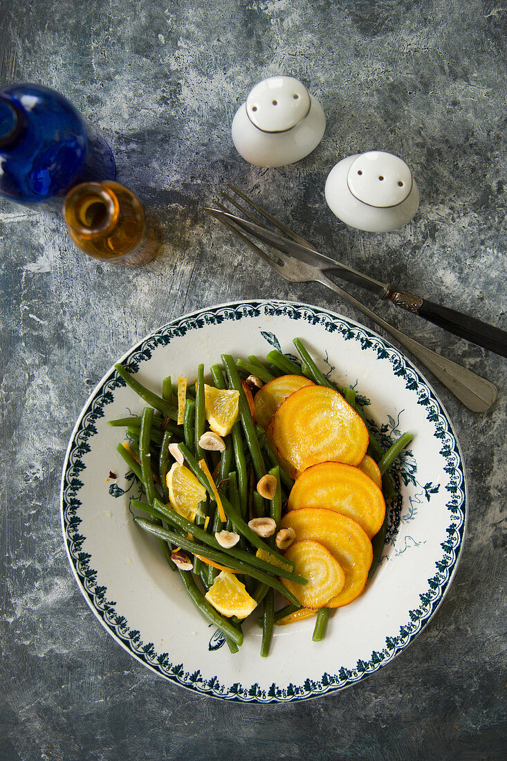 Yellow beets with green beans and hazelnuts