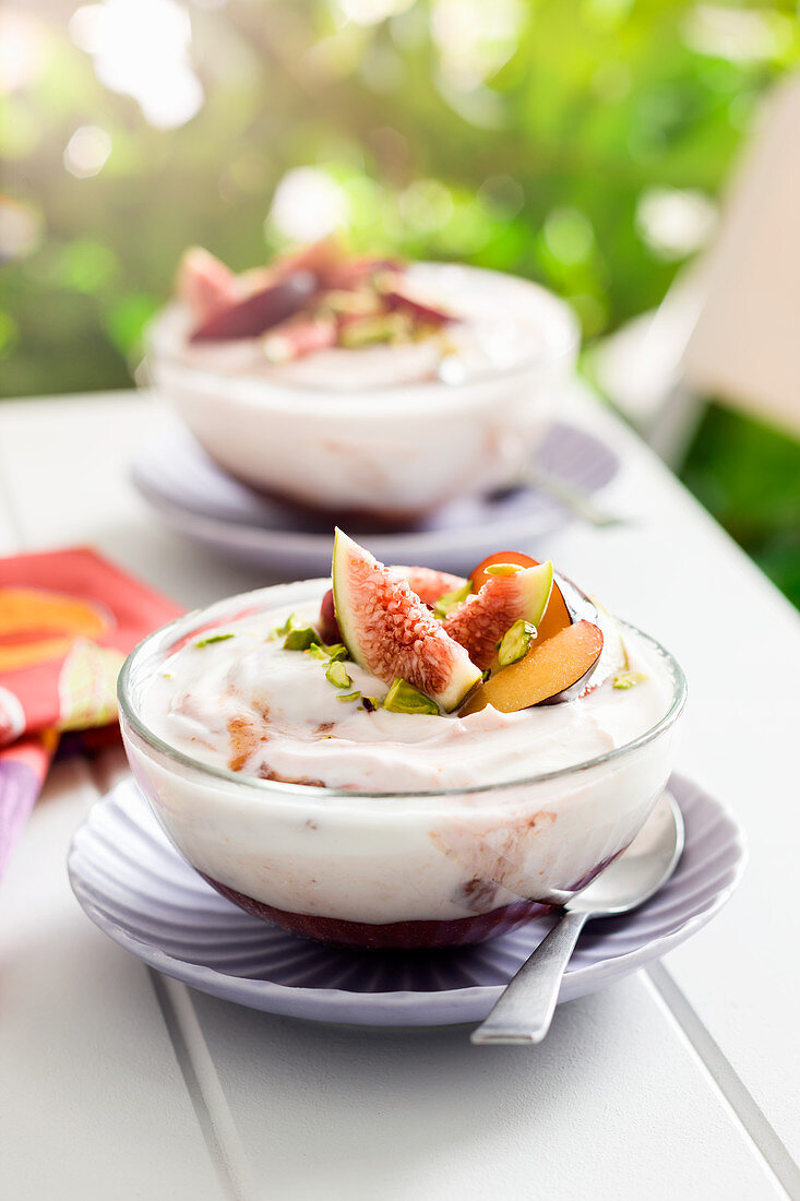 Yoghurt with berry compote, figs and pistachios
