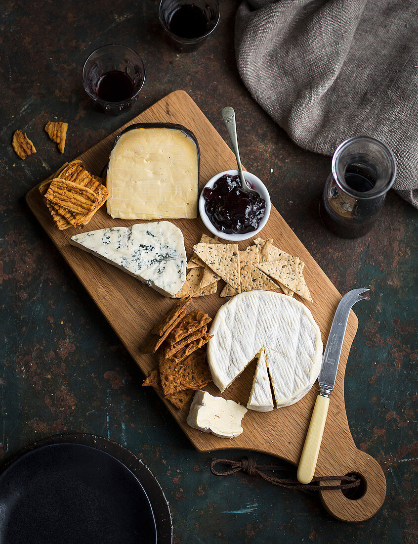 A cheese board with crackers
