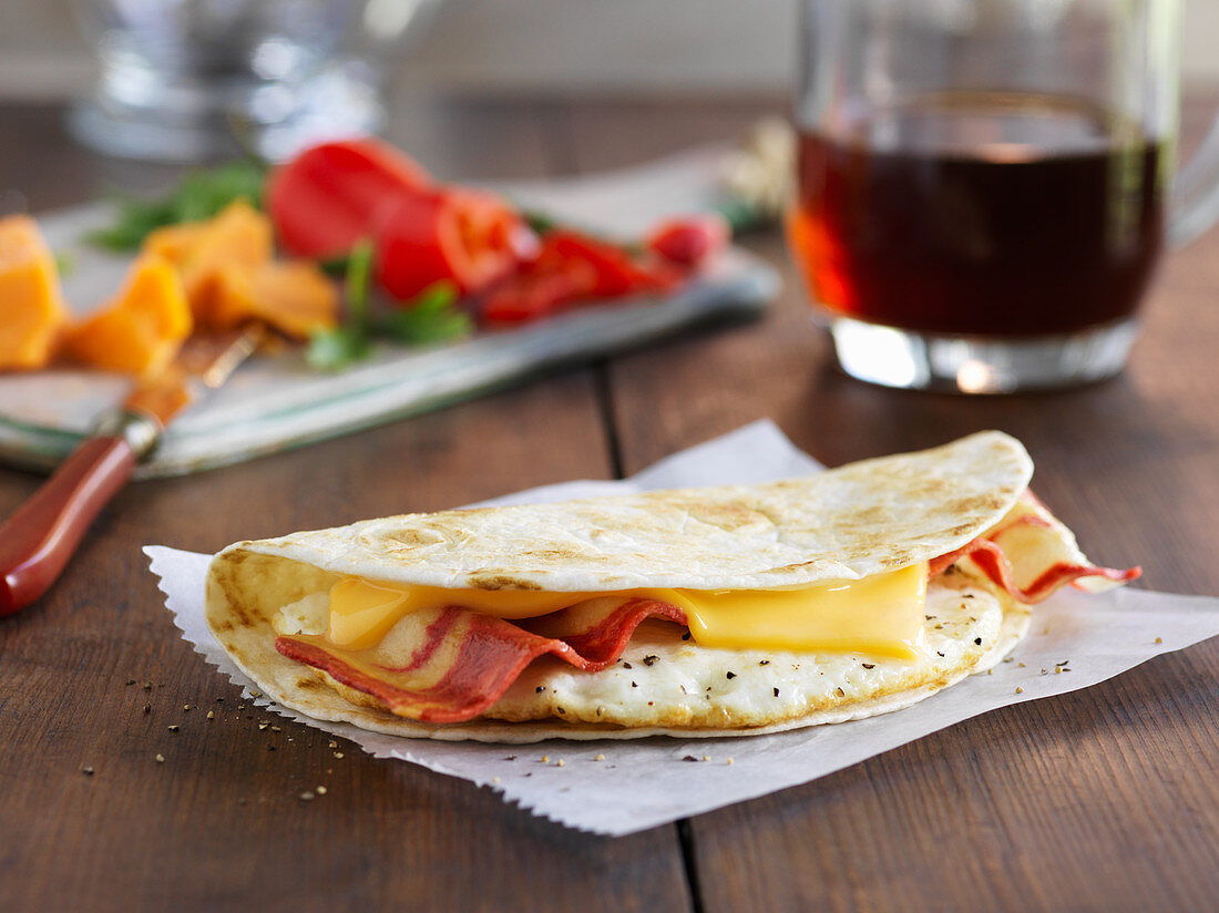 A breakfast omelette with egg, bacon and cheese