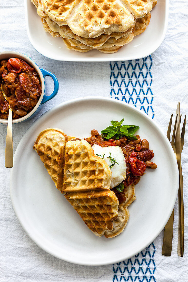 Oat waffles with maple syrup beans and a poached egg