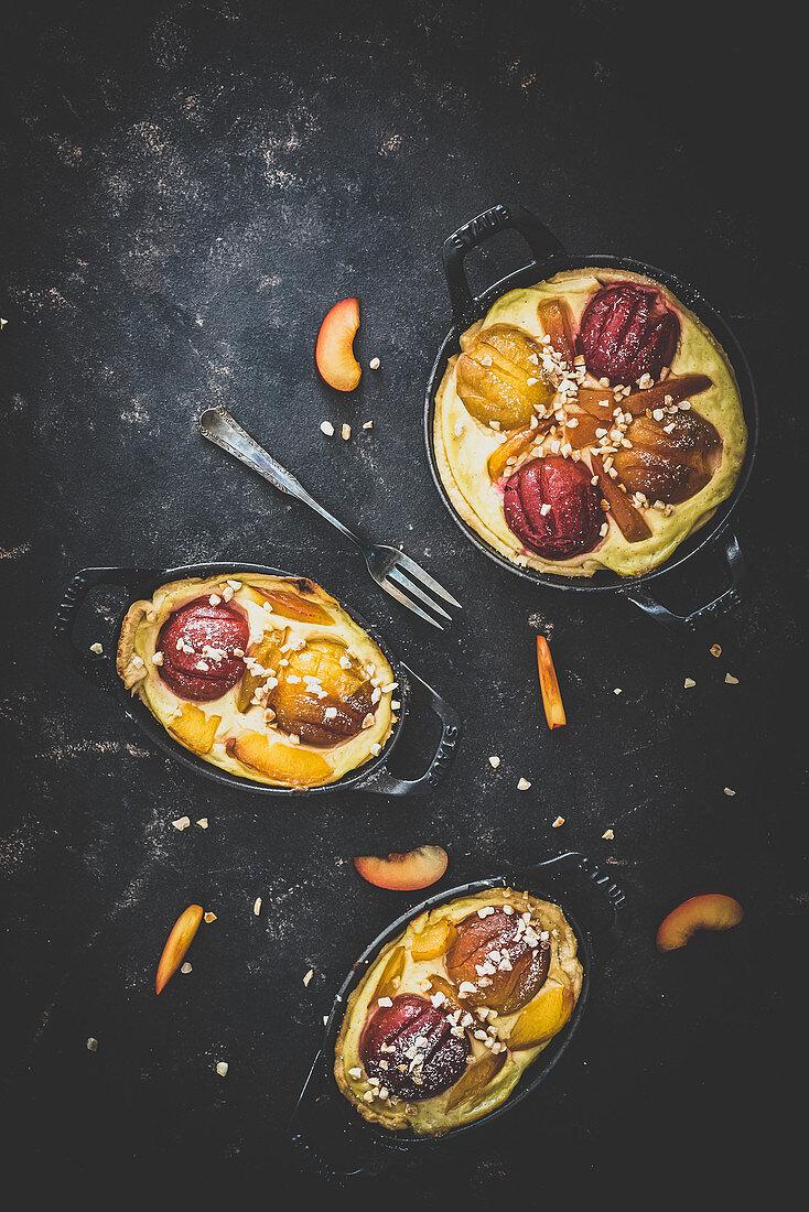 Small plum and vanilla tarts with nib sugar