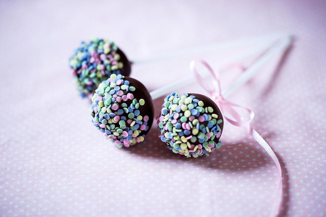 Vegan cupcakes with dark chocolate glaze and sugar confetti