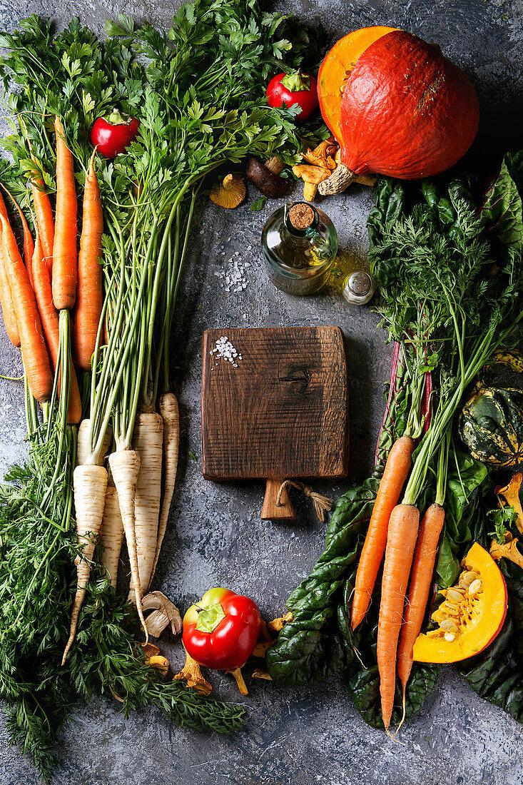 Variety of autumn harvest vegetables carrot, parsnip, chard, paprika, hokkaido pumpkin, mushrooms