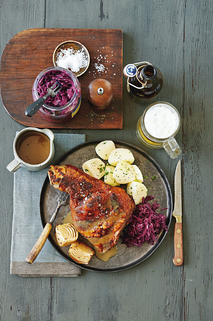 Roast pork with a beer sauce and red cabbage