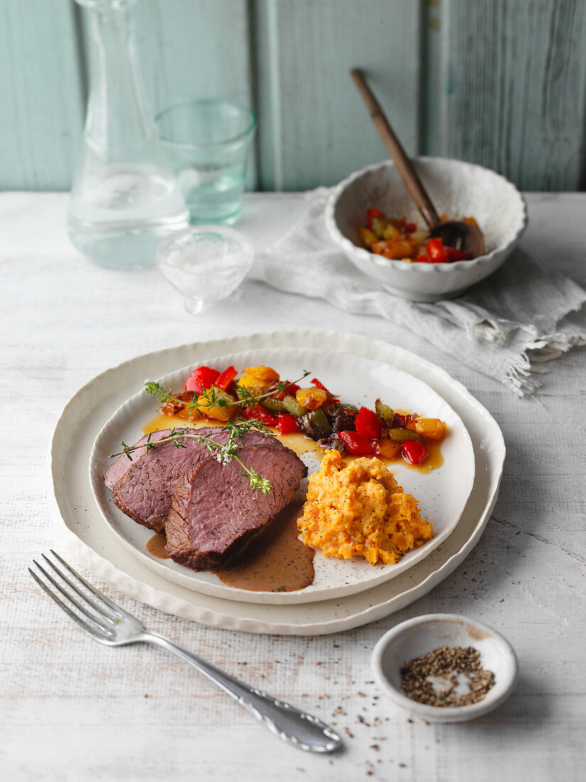 Ostrich fillet in a honey and balsamic vinegar sauce with a pepper medley