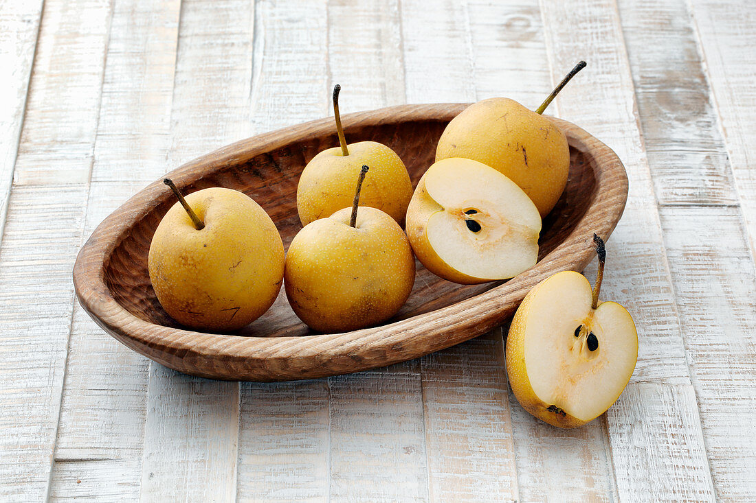 Nashi pears in a wooden bowl