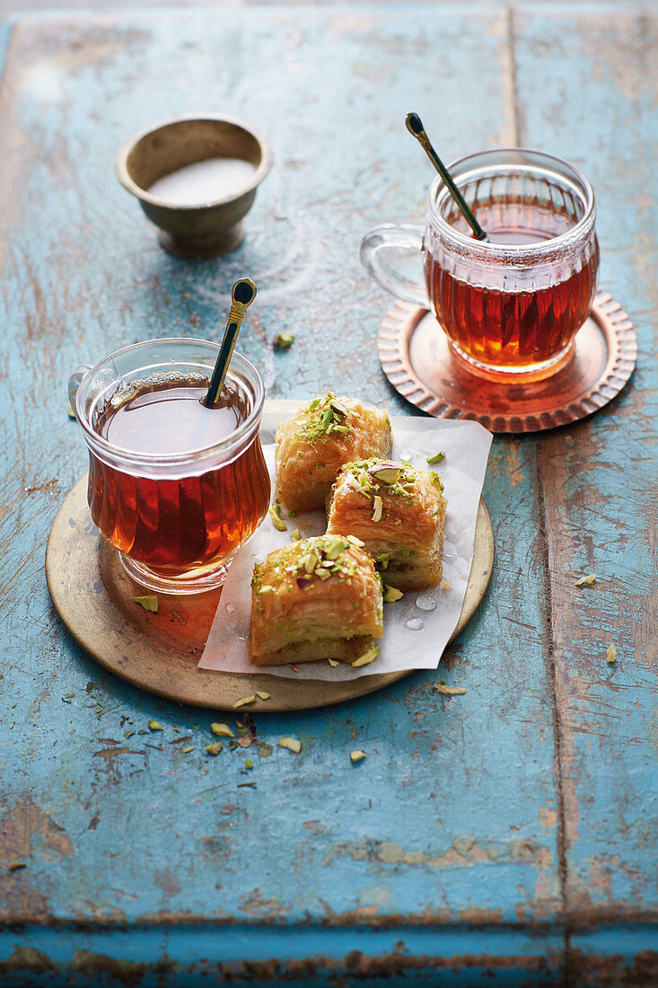 Baklava (oriental puff pastry cakes with pistachio nuts)