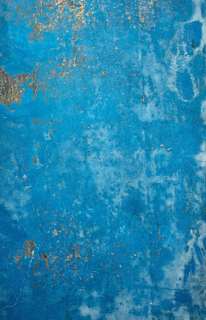 A blue and gold marbled surface
