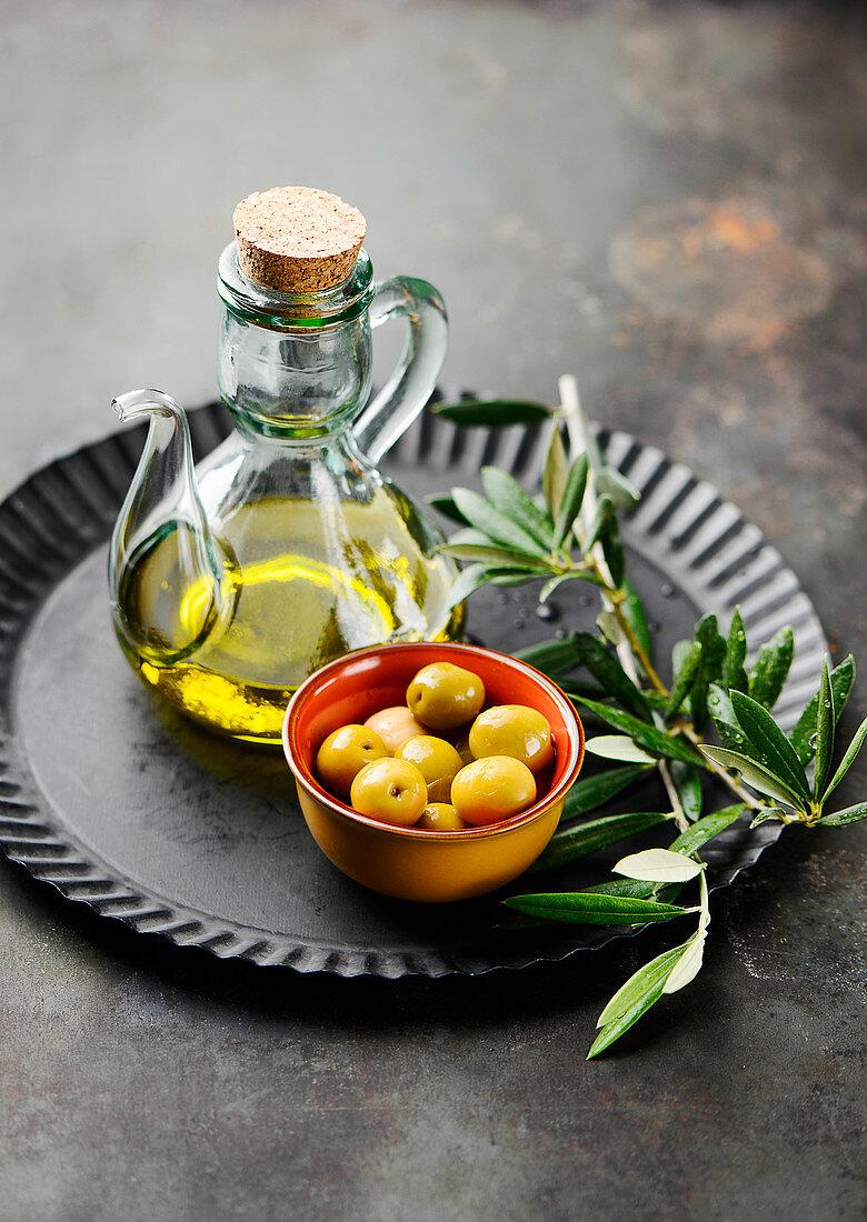 Olives, olive oil and an olive sprig