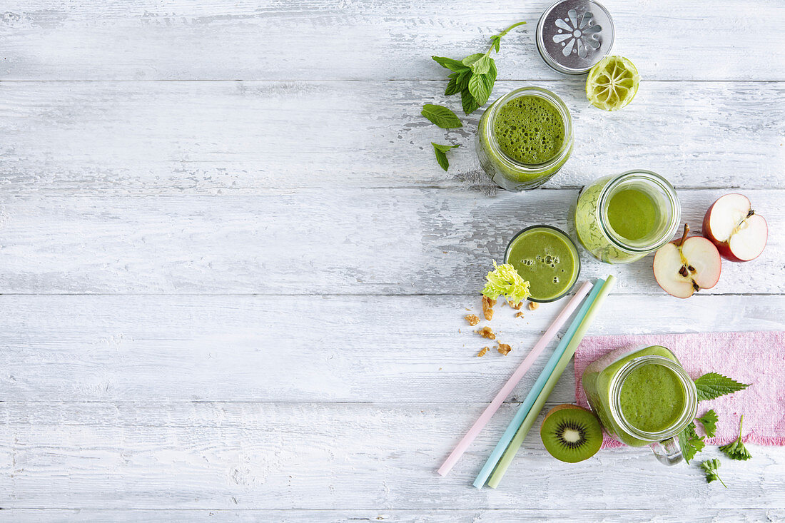 Green smoothies with fruit, vegetables and herbs
