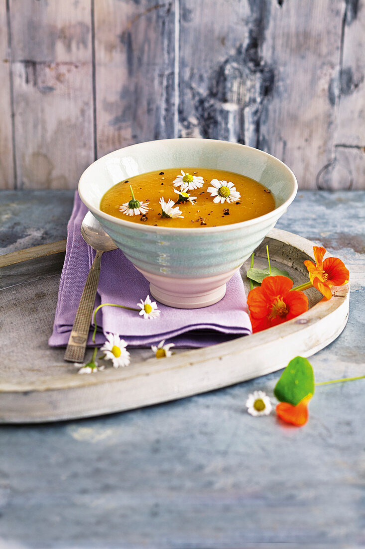 Vegan potato soup with daisies
