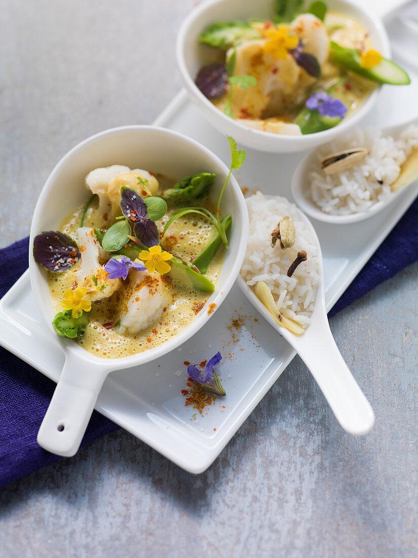 Vegetarian cauliflower curry with cardamom rice and okra