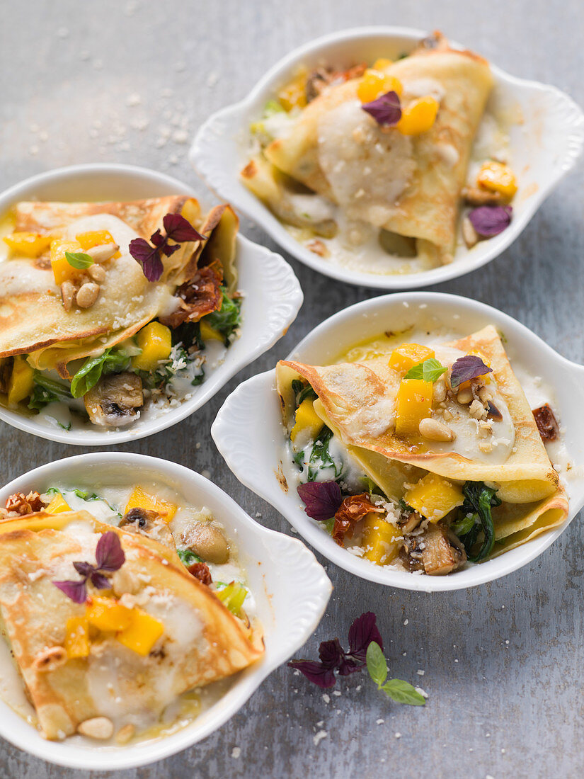 Savoy cabbage and spinach crepes with mango and lime