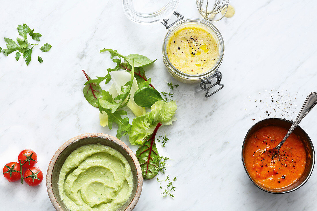 Parsley hummus, apple dressing and tomato dressing with chilli