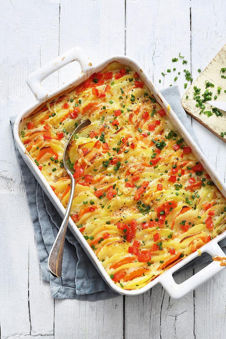 Vegetarian potato gratin with colourful vegetables
