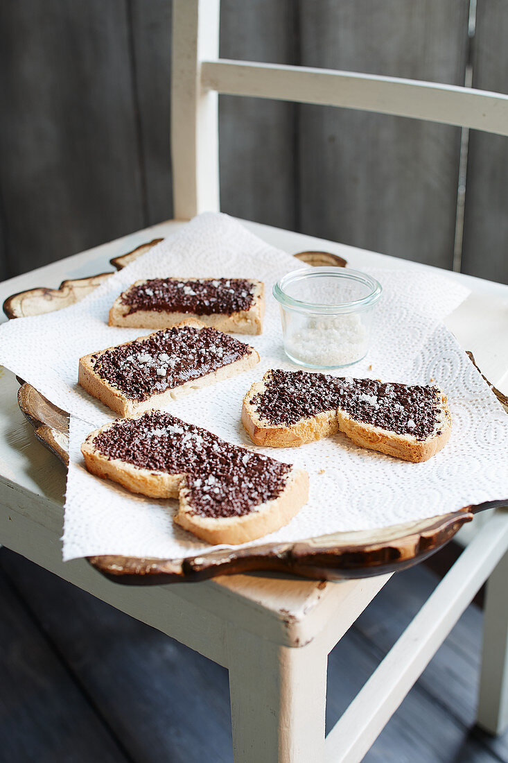 Chocolate bread with salt on a wooden chair