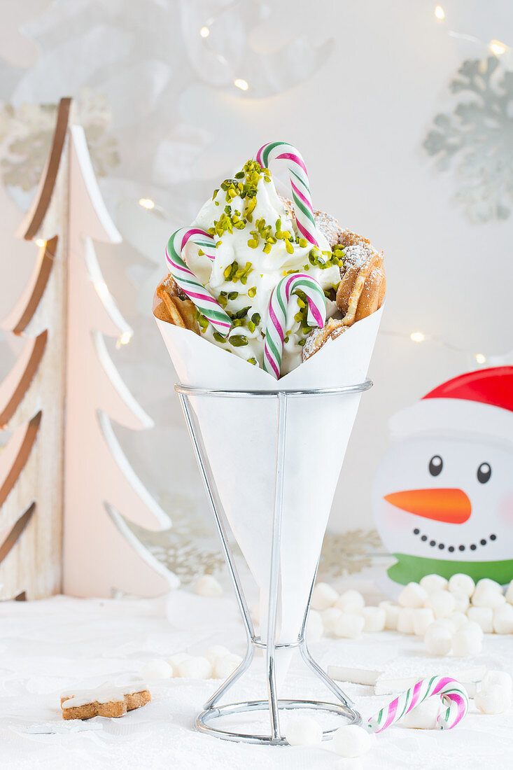 A bubble waffle with frozen yoghurt and candy canes for Christmas