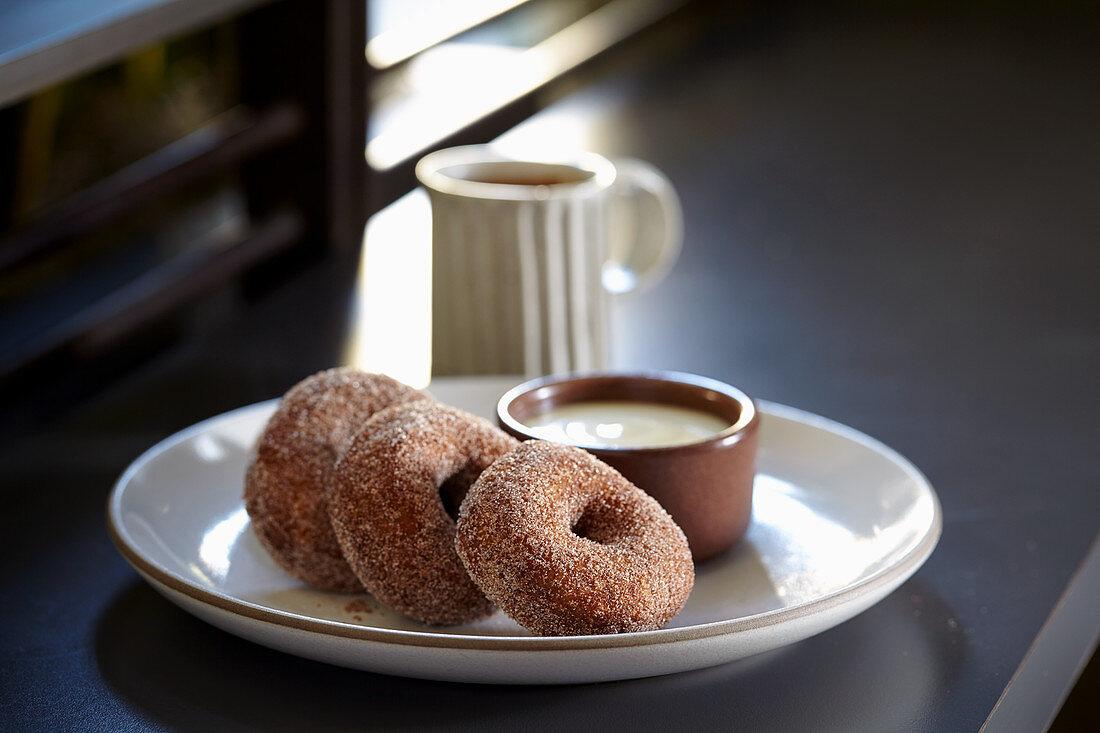 Buckwheat doughnuts with creme anglaise and coffee