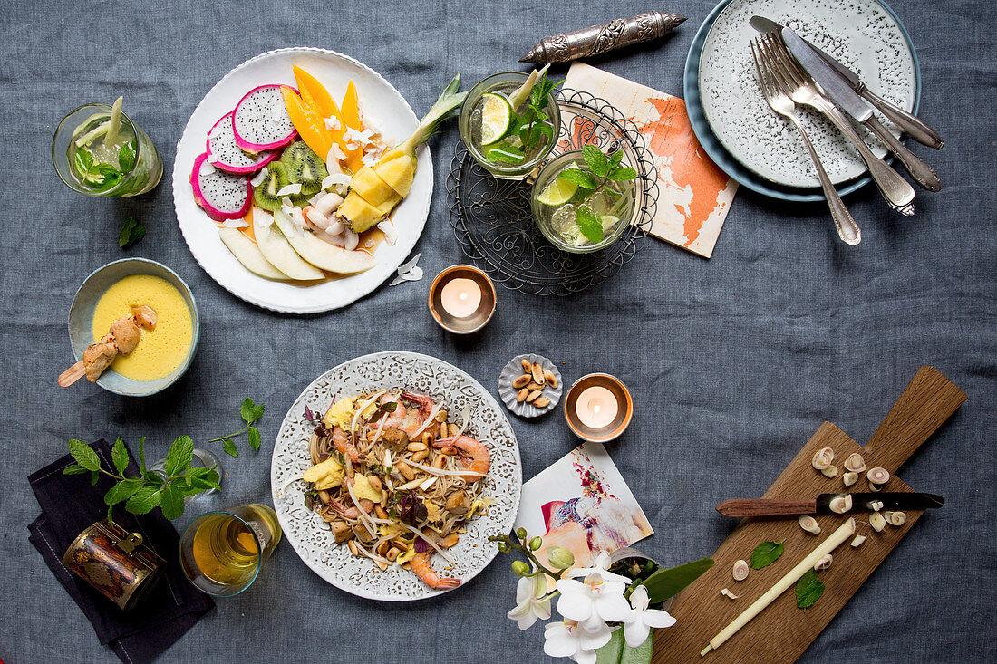 Fruit salad, Pad Thai, coconut soup, lemonade and a mojito