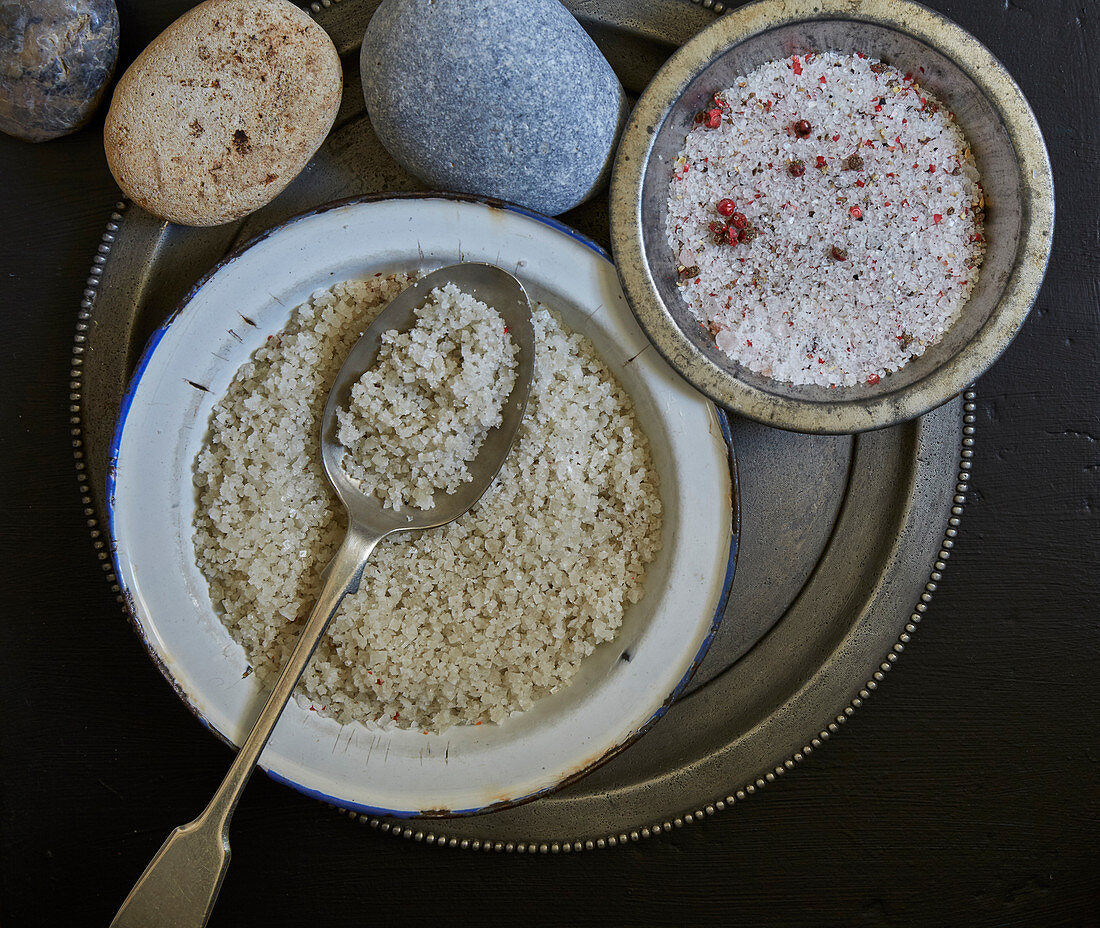 Grey sea salt in a bowl with a spoon