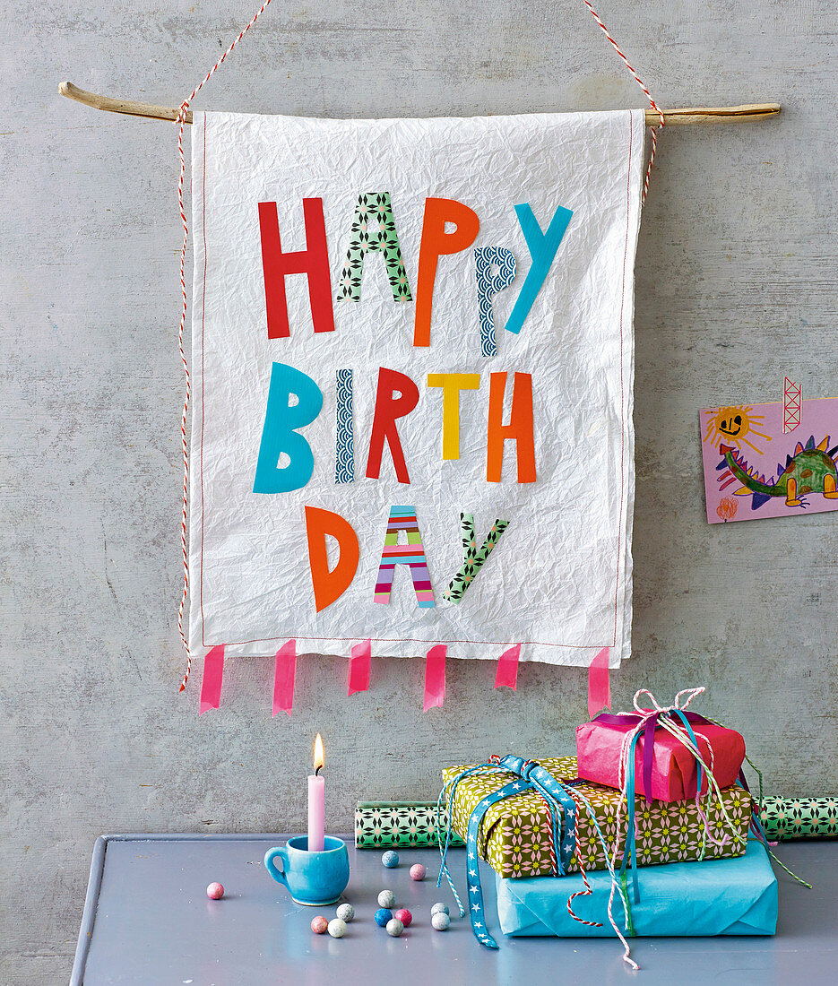 A Happy Birthday banner and colourful presents for a child's birthday