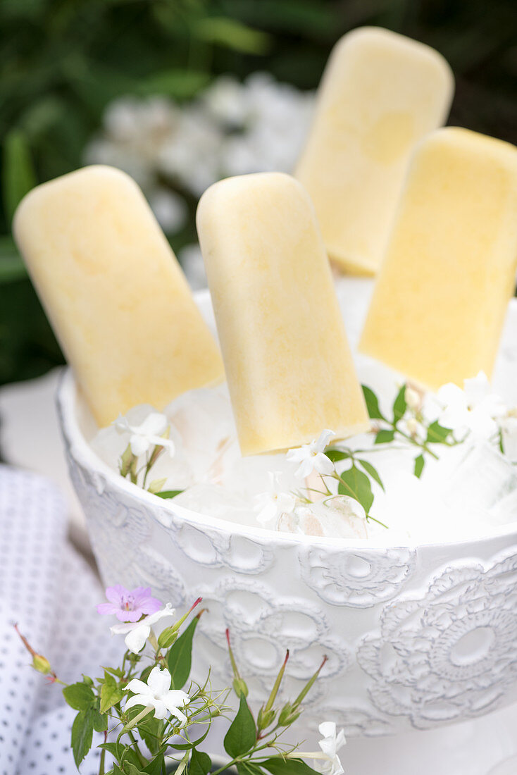 Mango and lime ice lollies in an ice bucket