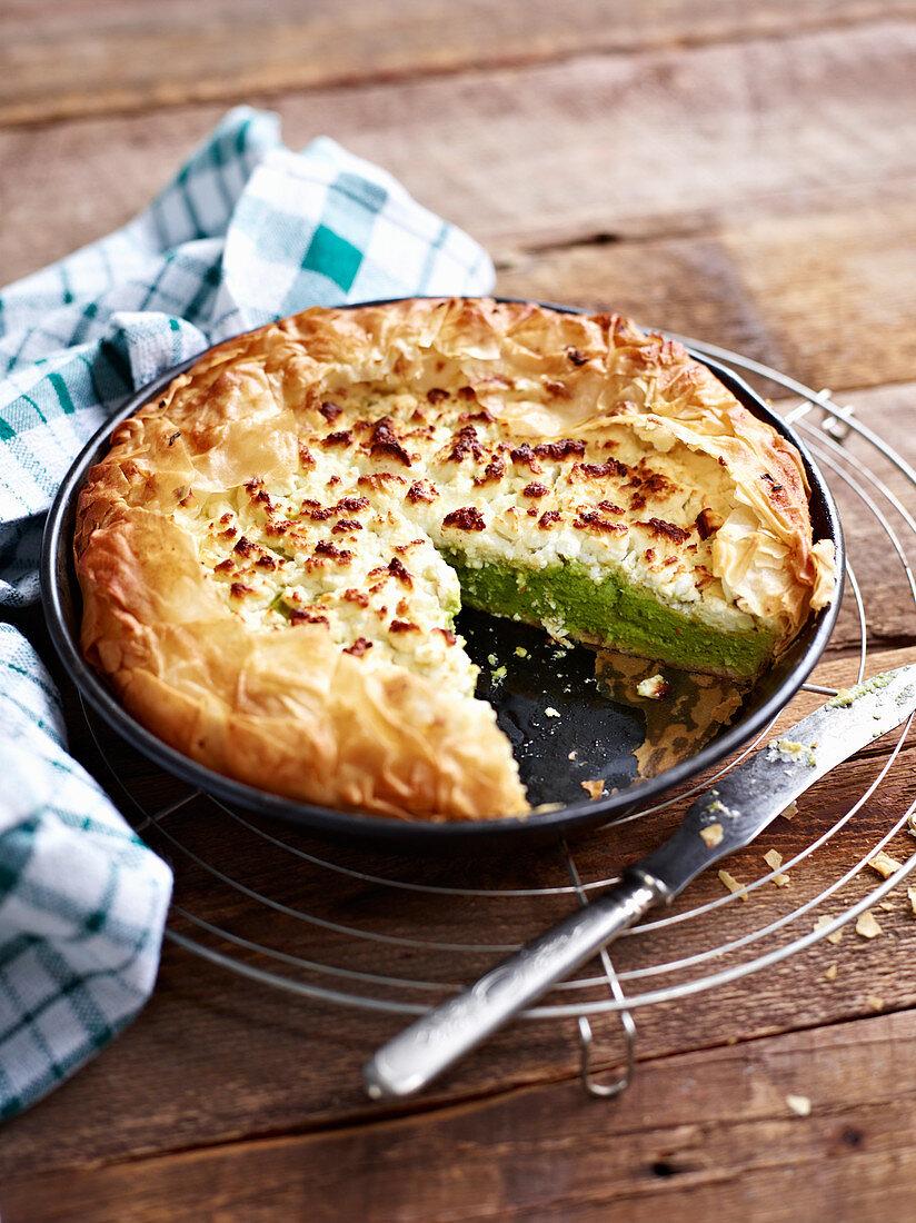 Broccoli tart, sliced, in a baking tin