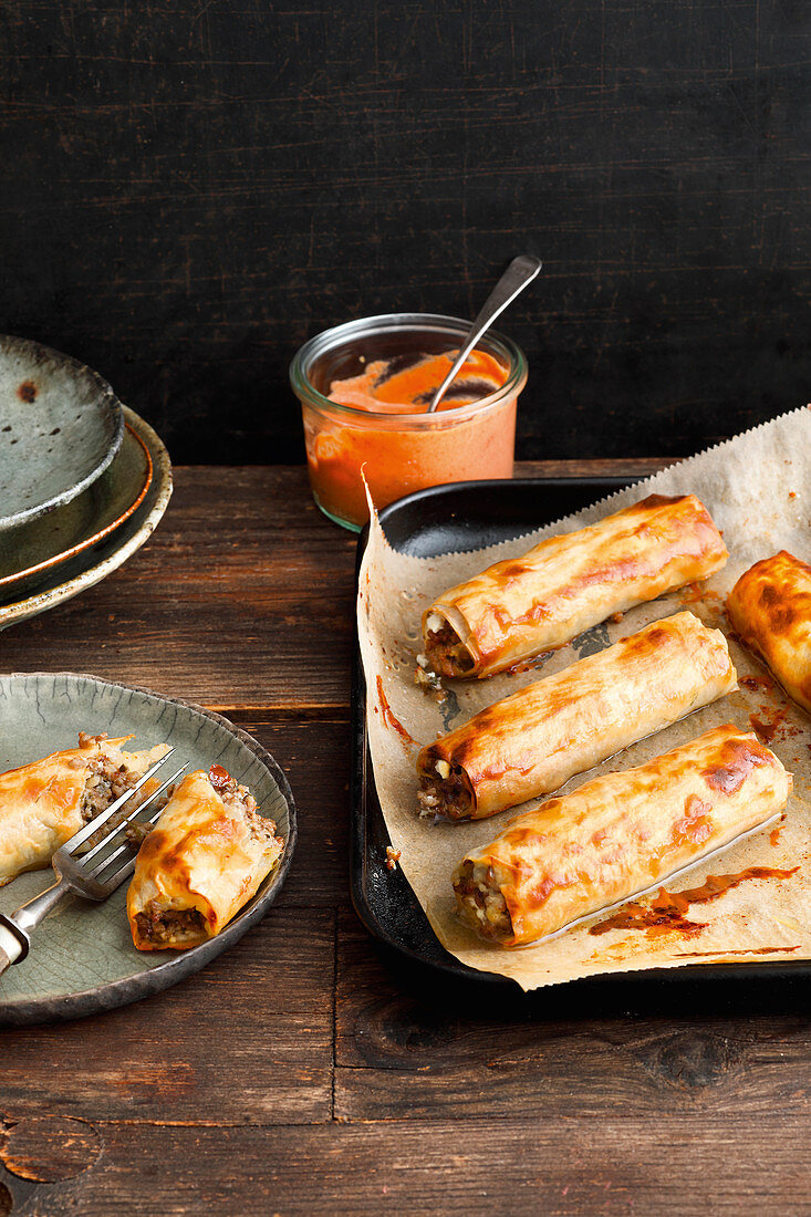 Hellas filo pastry rolls with minced lamb from a baking tray