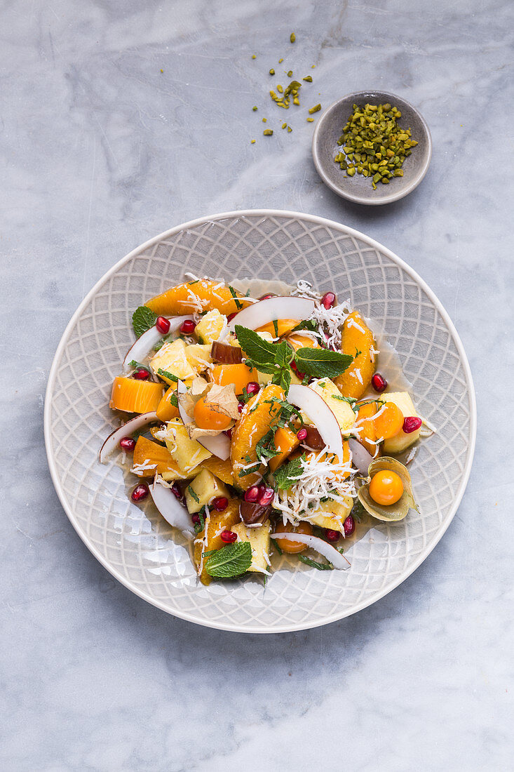 Arabian fruit salad with mint and pomegranate seeds