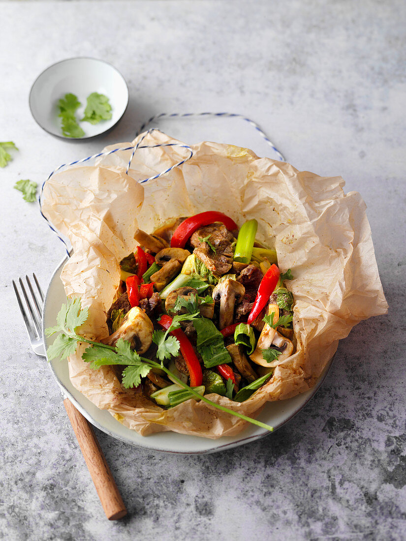 Oven-baked pork and mushroom packet with peppers