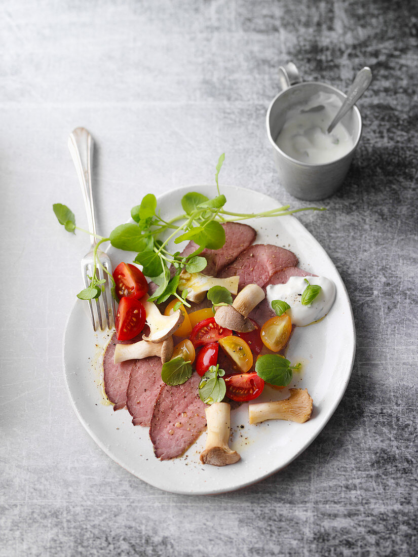 Marinated roast beef with water cress and king trumpet mushrooms