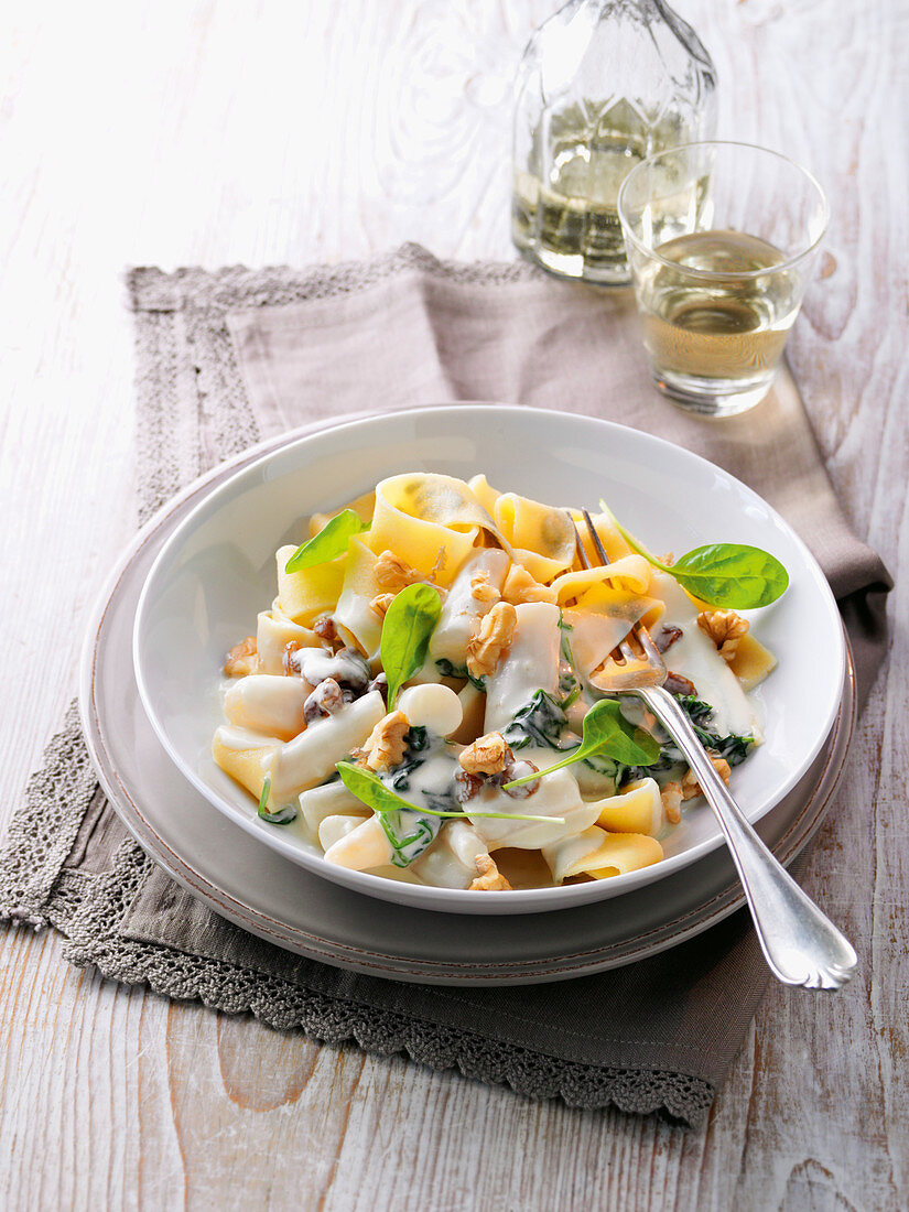 Herb tagliatelle with a black salsify and spinach ragout