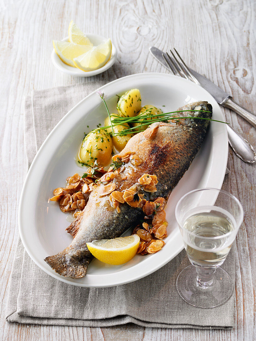 Fried trout with potatoes and almond sauce