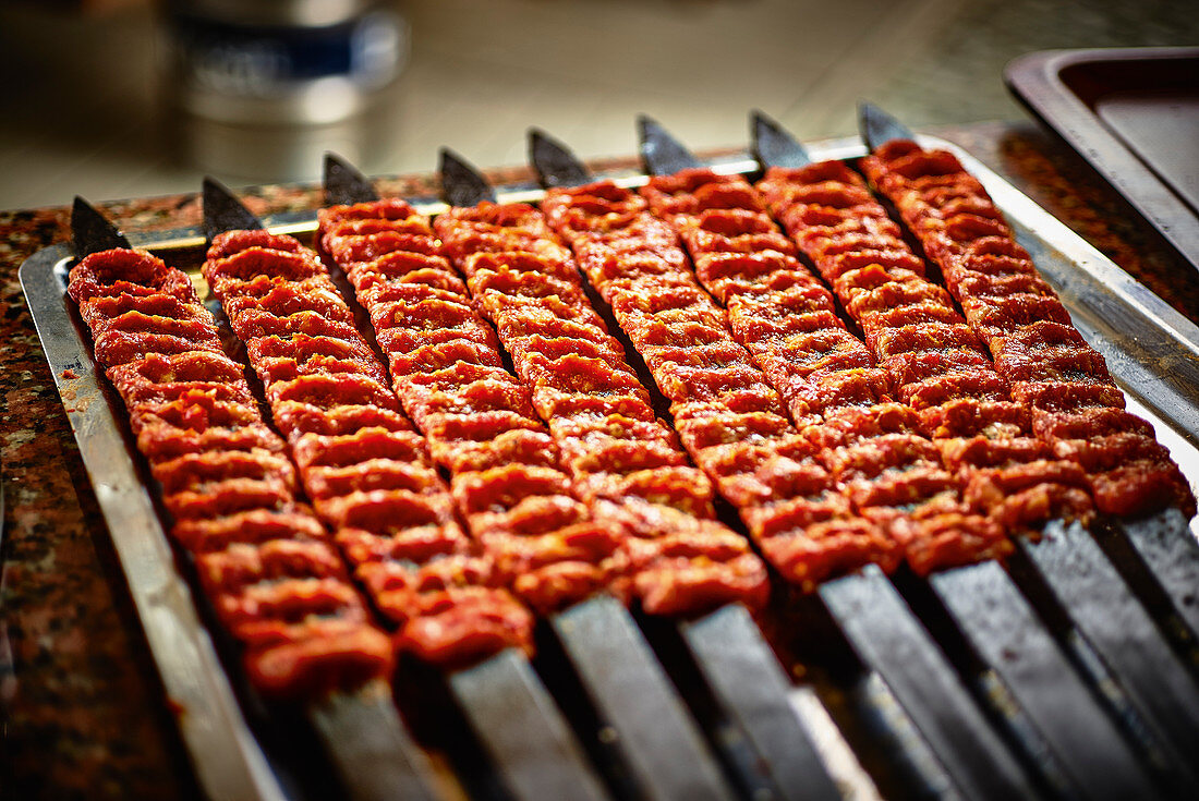 Turkish minced meat skewers on a grill