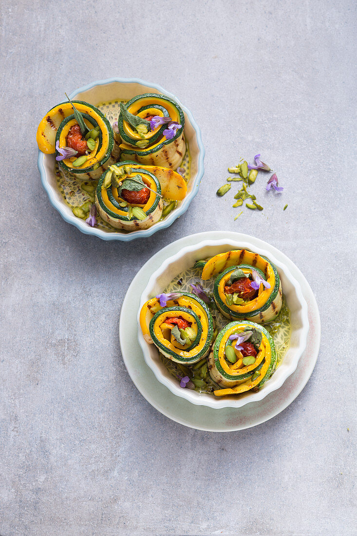 Stuffed, oven-baked courgette rolls