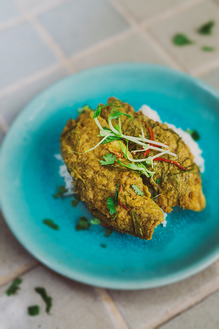 Curry coated fish with basmati rice