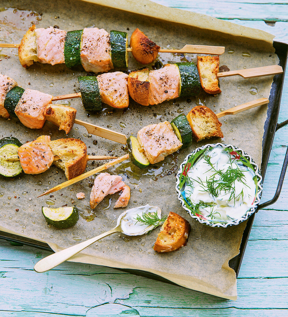 Oven-baked salmon and courgette skewers with a dill and sour cream dip