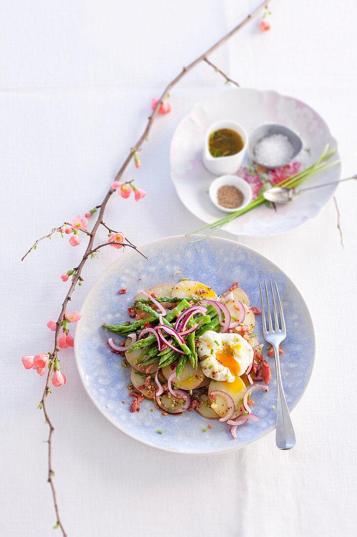 Warm potato salad with poached eggs